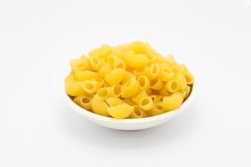 Bowl of Raw macaroni pasta on white background