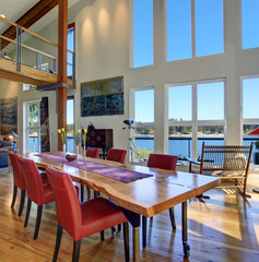 Luxury dinning area with large table and windows.