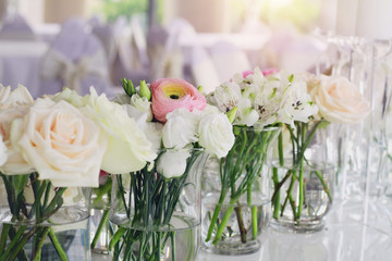 Wedding flower arrangement , pink ranunculus, white roses