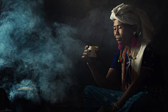 Tribal women are smelling scents aromatic coffee. She planted herself