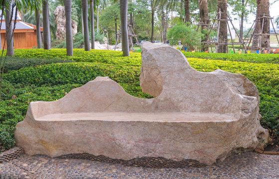 Marble stone garden bench in the public park