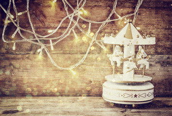 image of old vintage white carousel horses with garland