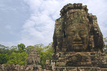 Walk into Bayon Temple with a welcoming smile
