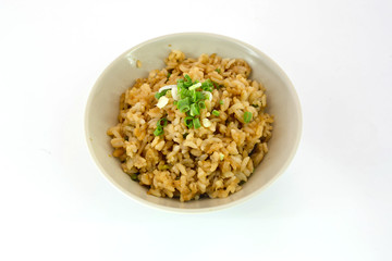 garlic fried rice with vegetable on top