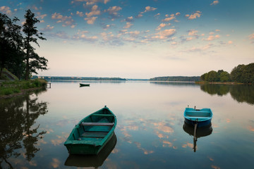 Rowing boats floating over the Lake Elk waters. Masuria, Poland.