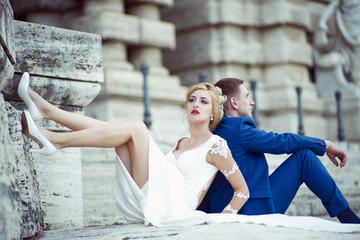 Wedding couple sitting outdoor