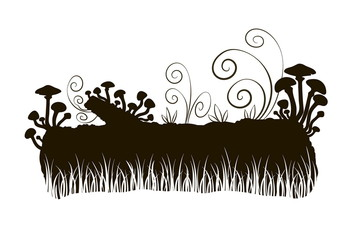 silhouette of a fabulous mushrooms on a log in the grass