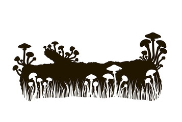 silhouette of black and white mushrooms on a log in the grass