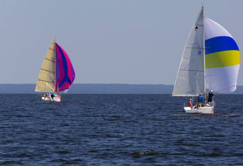 yacht with brightly colored sails