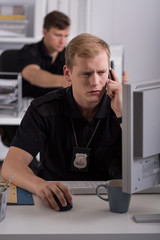 Man working on police helpline