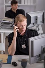 Policeman talking on phone