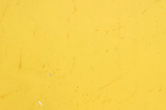Dirty yellow paint wall texture background