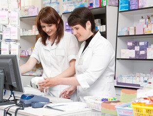 Two Friendly Pharmacists Working Together in the Drugstore.