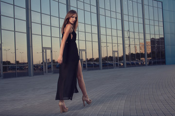 fashionable woman on urban background