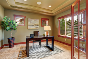 Luxury home office with green interior paint.