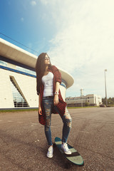 Attractive Hipster Fashion Girl With Skateboard