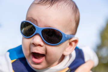 Nice baby with blue googles