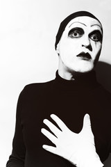 Theatrical actor with dark mime makeup