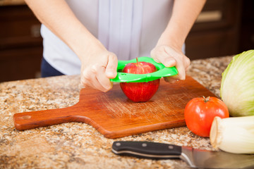 Slicing an apple in the kitchen