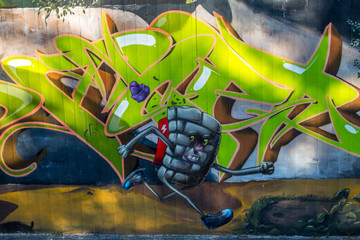 Graffiti: Rennende Mauer