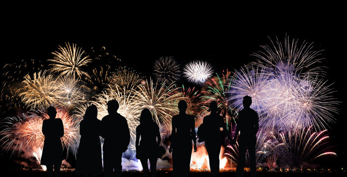 Group of people looks beautiful colorful holiday fireworks