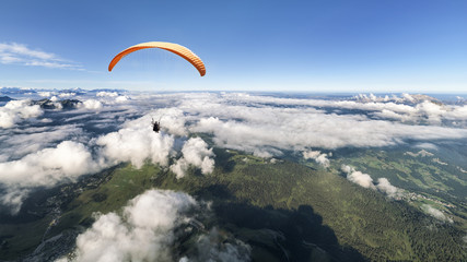 Wall Murals Sky sports Two-seater paraglider above the clouds