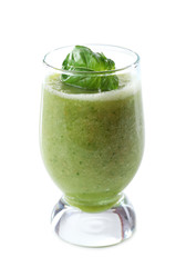 Glass of green healthy juice with basil isolated on white