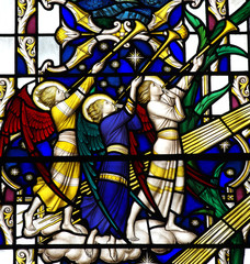 Fototapete - Angels blowing on a trumpet (stained glass)
