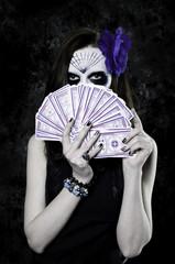 Dark with with Halloween makeup and tarot cards