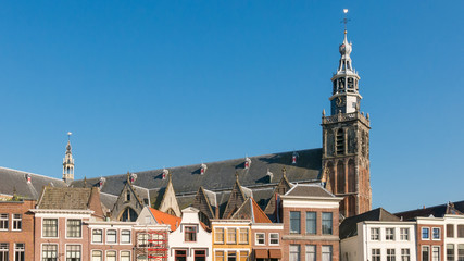 Saint John's Church and facades of old houses on Market Square in Gouda, Netherlands