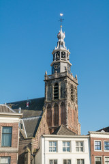 Saint John's Church tower and facades of houses on Market Square in Gouda, the Netherlands