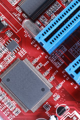 Close-up of electronic circuit red board with processor of compu