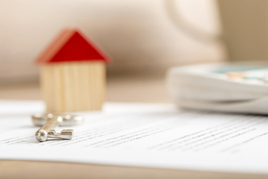 Closeup of contract of house sale ready to be signed