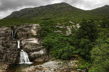 Glen Coe, Scotland, waterfall with mountains and cloud in background