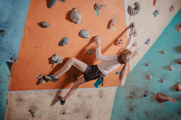 Climber girl training in gym