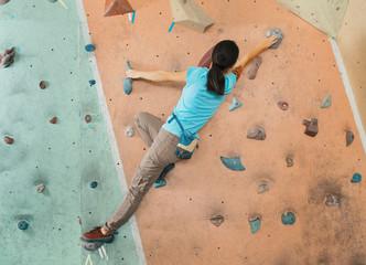 Free climber woman training indoor