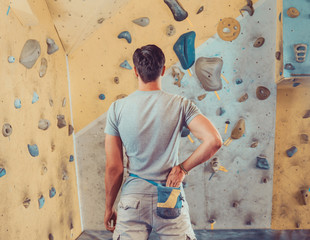 Sporty man preparing to climb