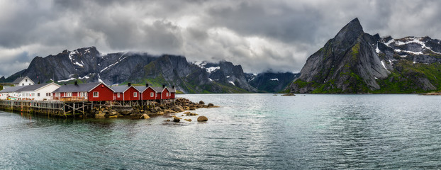 Wall Mural - Mount Olstind above red fishing cabins in Hamnoy, Norway