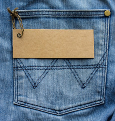 Blank card for your text in a jeans pocket