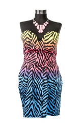 Colorful zebra pattern dress with matching necklace on a mannequin. Woman summer outfit on tailor's dummy isolated on white background.
