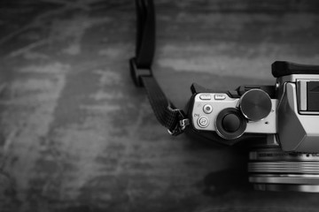 Photo of DSLR camera in black and white.