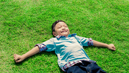Young boy lying in the grass