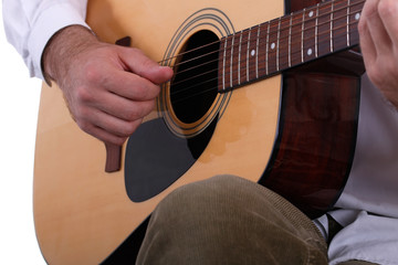 Man playing the acoustic guitar close-up