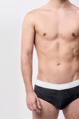 Fit male posing in underwear