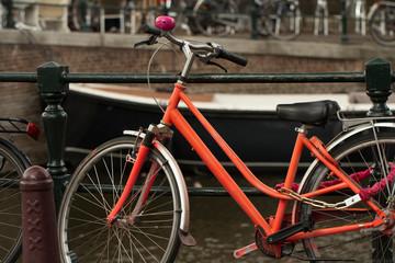 red vintage bike on the street in amsterdam