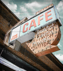 aged and worn vintage cafe neon sign