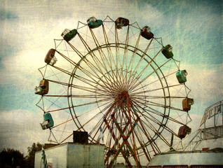 aged and worn vintage photo of ferris wheel