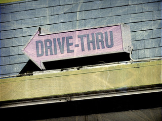 aged and worn vintage photo of drive thru sign