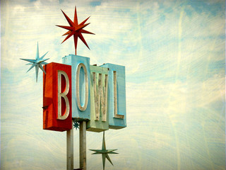 aged and worn vintage photo of neon bowl sign