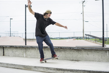 Older skateboard enthusiast skating around in skate park